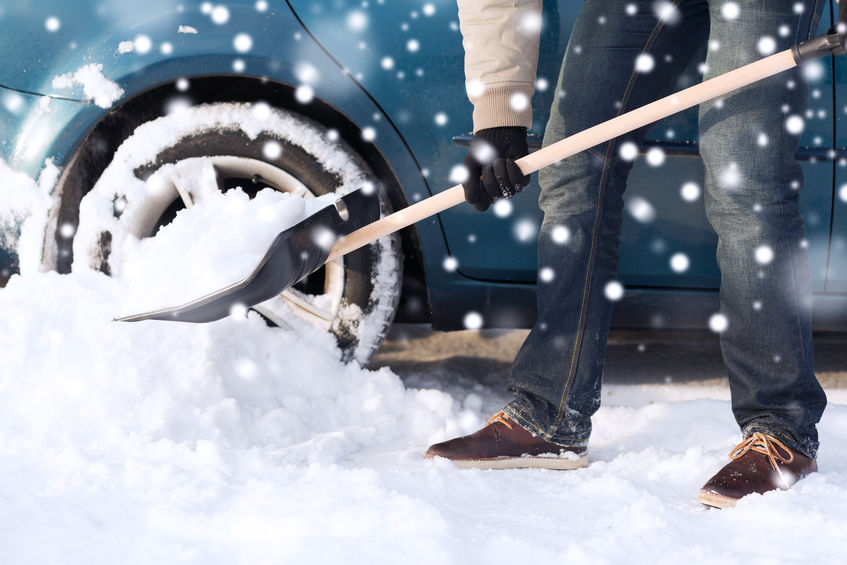 Man without snowmelt driveway shovels snow
